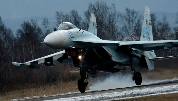 Su-27SM fighter lands as part of the tactical flight drill by fighter aircraft of the Eastern Military District conducted at Tsentralnaya Uglovaya military airfield in Primorye Territory. - Sputnik International