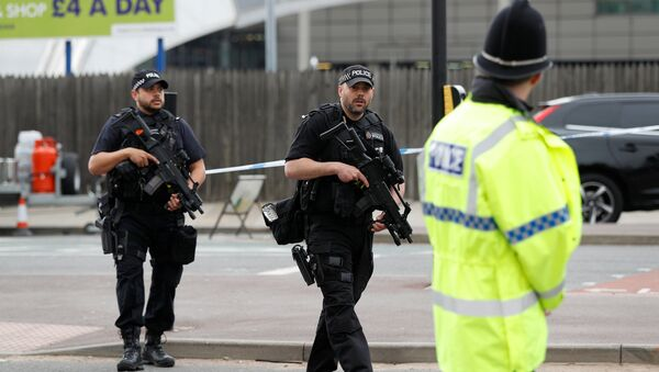 Armed police stand near the Manchester Arena in Manchester, Britain May 24, 2017. - Sputnik International