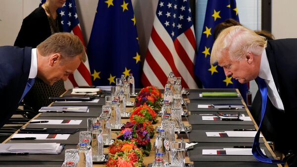 U.S. President Donald Trump (R) and the President of the European Council Donald Tusk take their seats before their meeting at the European Union headquarters in Brussels, Belgium, May 25, 2017. - Sputnik International