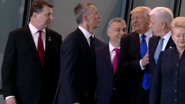 In this image taken from NATO TV, Montenegro Prime Minister Dusko Markovic, second right, appears to be pushed by US President Donald Trump - Sputnik International