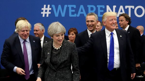 Britain's Foreign Secretary Boris Johnson (L), U.S. President Donald Trump (R) and Britain's Prime Minister Theresa May (C) attend a working dinner meeting at the NATO headquarters during a NATO summit of heads of state and government in Brussels, Belgium, May 25, 2017. - Sputnik International