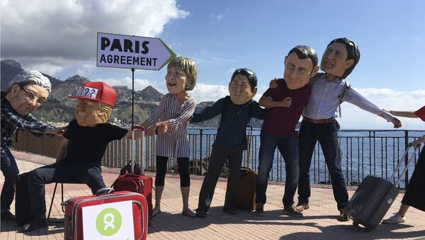 Oxfam activists wearing masks of the leaders of the G7 summit; from left, Italian Premier Paolo Gentiloni, US President Donald Trump, German Chancellor Angela Merkel, Japanese Prime Minister Shinzo Abe, French President Emmanuel Macron and Canadian Prime Minister Justin Trudeau, stage a demonstration in Giardini Naxos, near the venue of the G7 summit in the Sicilian town of Taormina, southern Italy, Friday, May 26, 2017 - Sputnik International