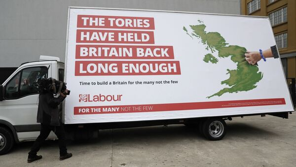 A cameraman films a poster unveiled by Britain's opposition Labour party for the upcoming general election, which their party leader Jeremy Corbyn did not attend, in London, Thursday, May 11, 2017 - Sputnik International
