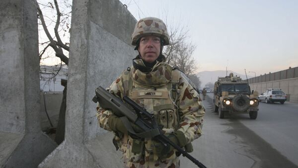An Australian soldier Mark Larter with the International Security Assistant Force walks during a patrolling on Christmas day in Kabul, Afghanistan, on Thursday, Dec. 25, 2008 - Sputnik International