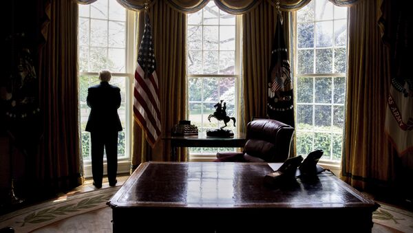 In this photo taken April 21, 2017, President Donald Trump looks out an Oval Office window at the White House in Washington following an interview with The Associated Press - Sputnik International