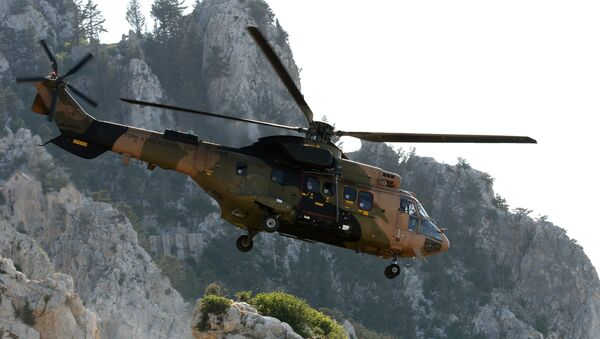 A Turkish army Cougar helicopter flies over the Saint-Hilarion mountain shane near Kyrenia during a search and rescue exercise in northern Cyprus, Tuesday, June 16, 2009 amid a dispute with Greek Cypriots over oil and gas exploration off the island. - Sputnik International