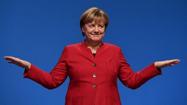German Chancellor Angela Merkel gestures after addressing delegates during her conservative Christian Democratic Union (CDU) party's congress in Essen, western Germany, on December 6, 2016. - Sputnik International
