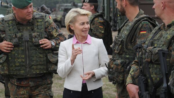German Defense Minister Ursula von der Leyen speaks with German soldiers after the NATO Noble Jump exercise on a training range near Swietoszow Zagan, Poland, Thursday, June 18, 2015. - Sputnik International