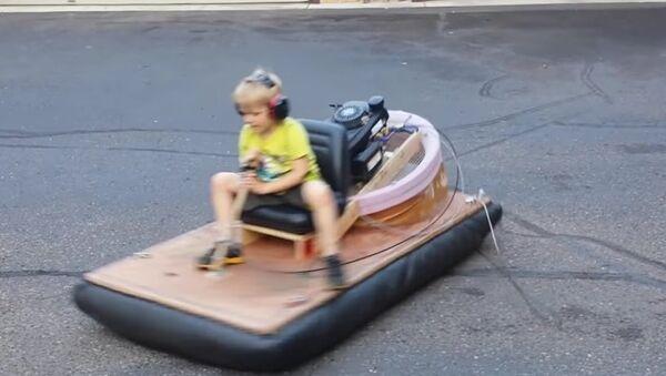Oliver riding the hovercraft - Sputnik International