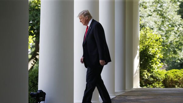 U.S. President Donald Trump enters the Rose Garden from the White House colonnade to announce his decision to leave the Paris Climate Agreement in the Rose Garden of the White House in Washington, U.S., JJune 1, 2017 - Sputnik International