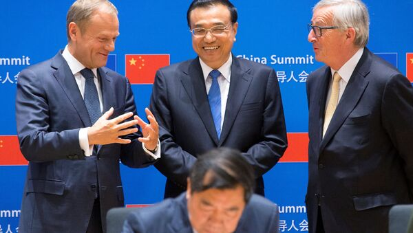European Council President Donald Tusk, Chinese Premier Li Keqiang and EU Commission President Jean-Claude Juncker attend a signing ceremony during a EU-China Summit in Brussels, Belgium June 2, 2017. REUTERS/Olivier Hoslet/Pool - Sputnik International