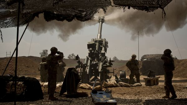 In this April 17, 2017 file photo, U.S. soldiers from the 82nd Airborne Division fire artillery in support of Iraqi forces fighting Islamic State militants from their base east of Mosul. - Sputnik International