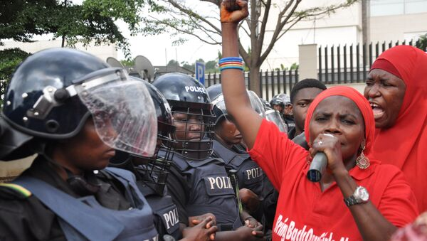 Police women in riot gear block the route during a demonstration calling on the government to rescue the kidnapped girls of the government secondary school in Chibok, in Abuja, Nigeria, Tuesday, Oct. 14, 2014. - Sputnik International