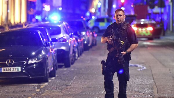An armed police stands on Borough High Street as police are dealing with an incident on London Bridge in London, Saturday, June 3, 2017. - Sputnik International