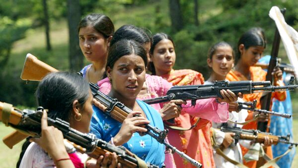 Women Village Defense Committee (VDC) members look on during a training session by the Indian Army at Sariya village, in Naushera sector, about 140 kilometers (88 miles) northwest of Jammu, India (File) - Sputnik International