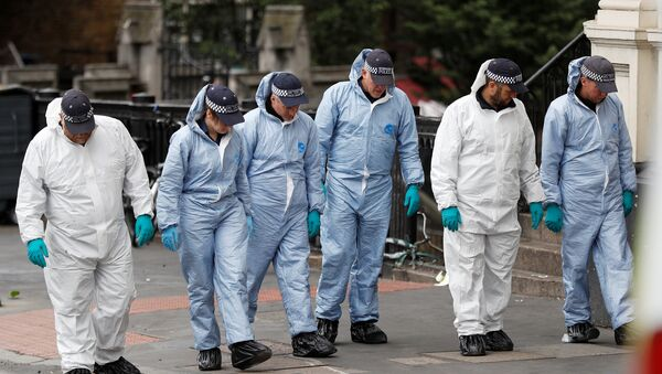 Forensics investigators work at the south end of London Bridge, near Borough market following an attack which left 7 people dead and dozens of injured in central London, Britain, June 5, 2017. - Sputnik International