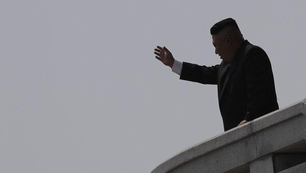 North Korean leader Kim Jong Un is seen in silhouette as he waves during a military parade in Pyongyang, North Korea - Sputnik International