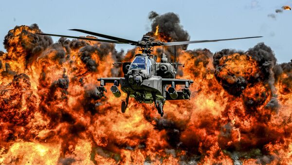 An AH-64D Apache attack helicopter flies in front of a wall of fire during the South Carolina National Guard Air and Ground Expo at McEntire Joint National Guard Base, South Carolina, U.S. on May 6, 2017 - Sputnik International