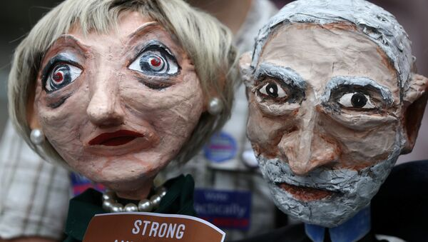 Puppets of Conservative Party leader Theresa May and Labour Party leader Jeremy Corbyn are seen during a protest against the BBC's broadcast restrictions on the Captain Ska song Liar Liar outside Broadcasting House in London, Britain June 2, 2017. - Sputnik International
