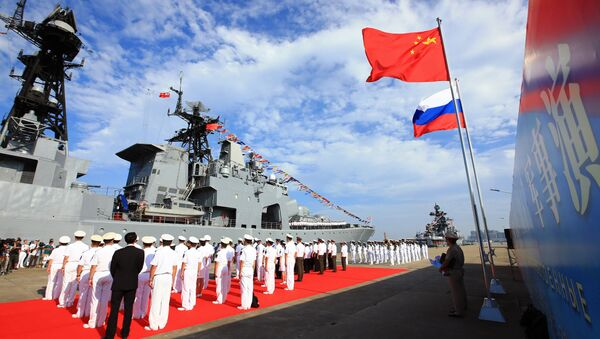 In this photo released by China's Xinhua News Agency, officers and soldiers of China's People's Liberation Army (PLA) Navy hold a welcome ceremony as a Russian naval ship arrives in port in Zhanjiang in southern China's Guangdong Province, Monday, Sept. 12, 2016 - Sputnik International