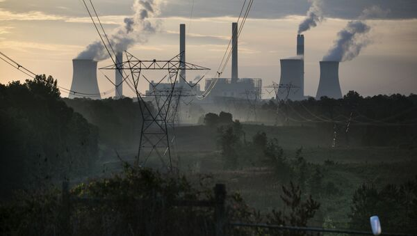 The coal-fired Plant Scherer, one of the nation's top carbon dioxide emitters, stands in the distance in Juliette, Ga., Saturday, June, 3, 2017. U.S. President Donald Trump declared Thursday he was pulling the U.S. from the landmark Paris climate agreement, striking a major blow to worldwide efforts to combat global warming and distancing the country from its closest allies abroad. - Sputnik International