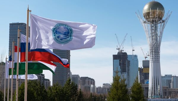 The flag of the Shanghai Cooperation Organization and flags of the SCO member states in Astana - Sputnik International
