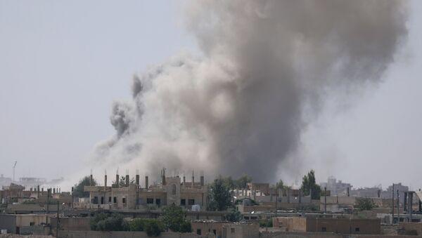 Smoke rises from the Raqqa province Syria. (File) - Sputnik International