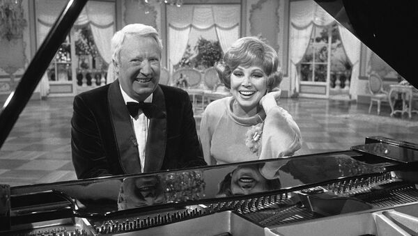 Former British Prime Minister Edward Heath and West German opera singer Anneliese Rothenberger pose sitting at a piano during an interval in shooting for a Television show in Hamburg, West Germany on May 17, 1977. - Sputnik International