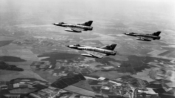 This file photo taken on March 1, 1967 shows Israeli airforce Dassault Mirage III fighters flying over Israel during a training three months ahead of the Six-Day Arab-Israeli war. - Sputnik International