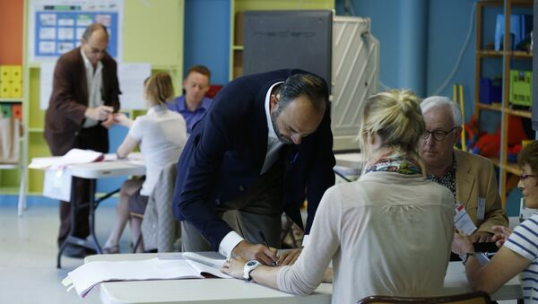 French Prime Minister Edouard Philippe prepares to cast his ballot at a polling station during the first round of legislative elections on June 11, 2017 in Le Havre, northern France. - Sputnik International