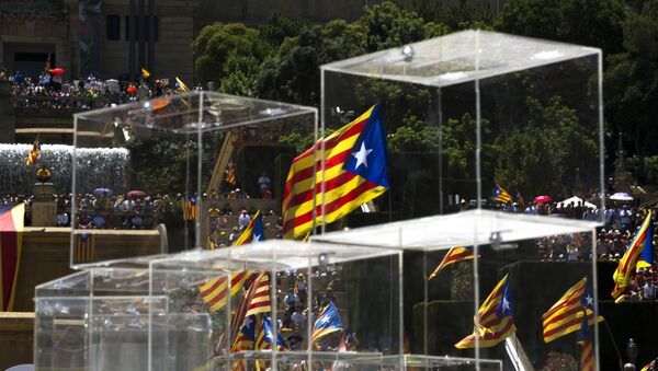 People wave pro independence flags next to ballot boxes during a protest organised by the National Assembly for Catalonia, to support the call for referendum in Barcelona, Spain - Sputnik International