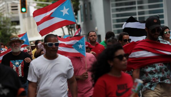 People march in support of Puerto Rico becoming an independent nation as the economically struggling U.S. island territory voted overwhelmingly on Sunday in favour of becoming the 51st state, in San Juan, Puerto Rico June 11, 2017 - Sputnik International