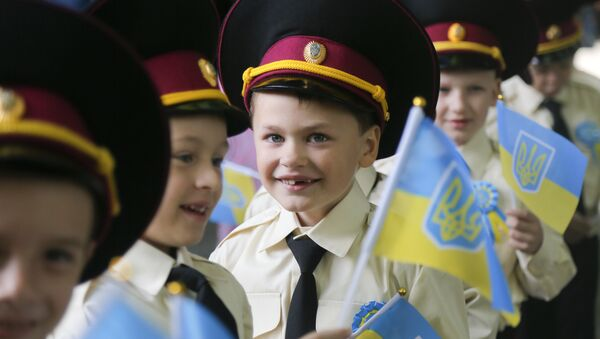 Seven-year old cadets hold Ukrainian flags as they attend a ceremony on the occasion of the first day of school at a cadet lyceum in Kiev, Ukraine, Thursday, Sept. 1, 2016 - Sputnik International
