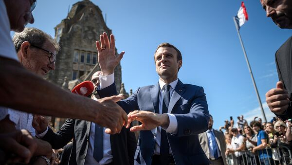 French President Emmanuel Macron leaves the polling station after voting in the first of two rounds of parliamentary elections in Le Touquet, France, June 11, 2017 - Sputnik International