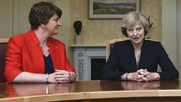 This is a July 25, 2016 file photo of of Arlene Foster, left, leader of the Democratic Unionist Party, with Britain's Prime Minister Theresa May, during a meeting in Belfast. - Sputnik International