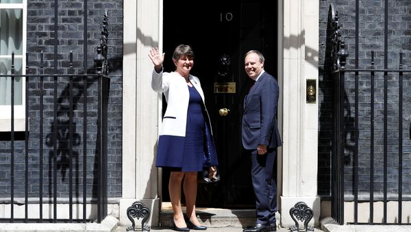 The leader of the Democratic Unionist Party (DUP), Arlene Foster, and the Deputy Leader Nigel Dodds, stand on the steps of 10 Downing Street before talks with Britain's Prime Minister Theresa May, in central London, Britain June 13, 2017 - Sputnik International