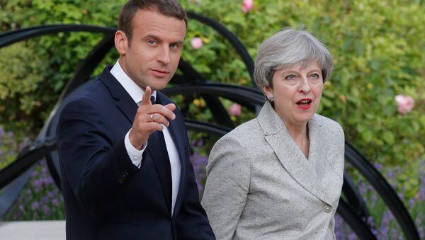 French President Emmanuel Macron (L) escorts Britain's Prime Minister Theresa May as they arrive to speak to the press at the Elysee Palace in Paris, France, June 13, 2017 - Sputnik International