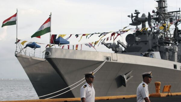 Indian sailors walk beside Indian Navy ships, from left, INS Ranvijay (D55), a Rajput class destroyer, and INS Saptura, a Shivalik-class stealth multi-role frigate, as they arrive at Berth 15, South Harbour, in Manila, Philippines on Wednesday, June 12, 2013 - Sputnik International