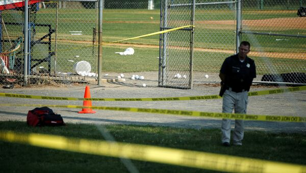 A police officer mans a shooting scene after a gunman opened fire on Republican members of Congress during a baseball practice near Washington in Alexandria, Virginia, June 14, 2017 - Sputnik International