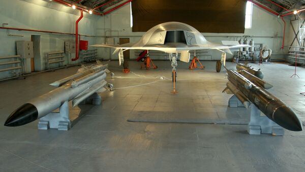 A full-sized model of the unmanned aerial vehicle Skat (background) and Kh-31 guided missiles (foreground) in a hangar of the Russian Aircraft Corporation MiG, the 8th MAKS-2007 air show in Zhukovsky - Sputnik International