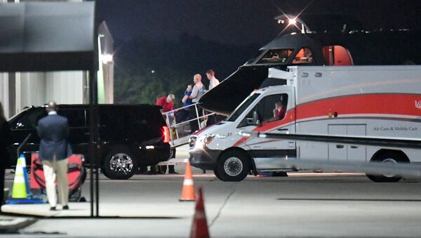 A person believed to be Otto Warmbier is transferred from a medical transport airplane to an awaiting ambulance at Lunken Airport in Cincinnati, Ohio, U.S., June 13, 2017 - Sputnik International