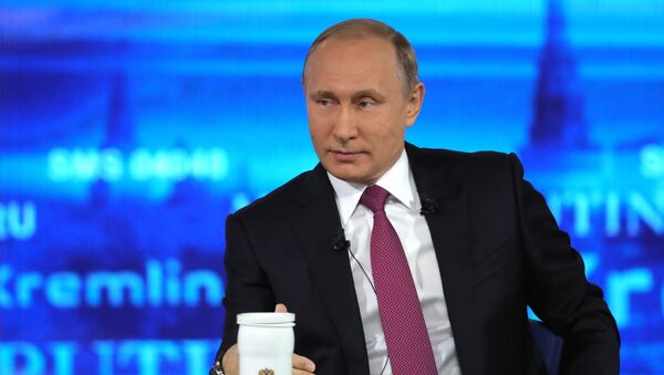 Russian President Vladimir Putin at the Gostiny Dvor studio during the annual Direct Line with Vladimir Putin broadcast live by Russian TV channels and radio stations - Sputnik International