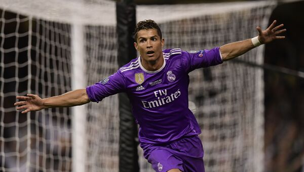 Real Madrid's Portuguese striker Cristiano Ronaldo celebrates after scoring their third goal during the UEFA Champions League final football match between Juventus and Real Madrid at The Principality Stadium in Cardiff, south Wales - Sputnik International