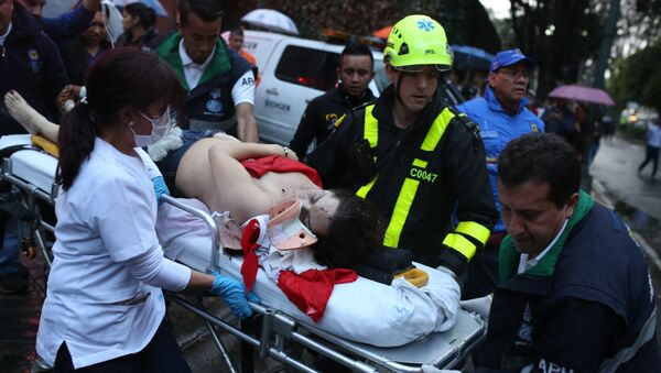 A woman is evacuated on a gurney after an explosion at the Centro Andino shopping center in Bogota, Colombia, Saturday, June 17, 2017. - Sputnik International
