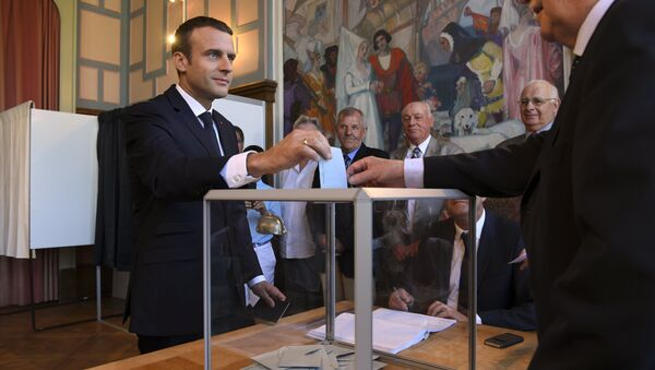 French President Emmanuel Macron casts his ballot as he votes at a polling station in Le Touquet, northern France, during the second round of the French parliamentary elections (elections legislatives in French) - Sputnik International