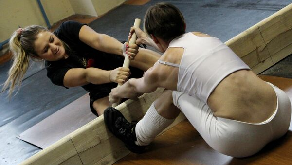 Participants compete at a New Year women's mas-wrestling tournament. (File) - Sputnik International