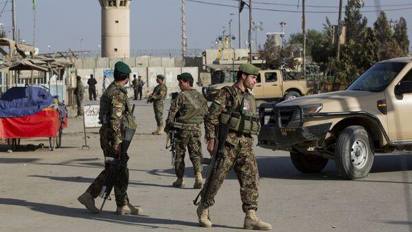 (File) Afghanistan's National Army soldiers guard, blocking the main road to the Bagram Airfield's main gate in Bagram, north of Kabul, Afghanistan, Saturday, Nov. 12, 2016 - Sputnik International