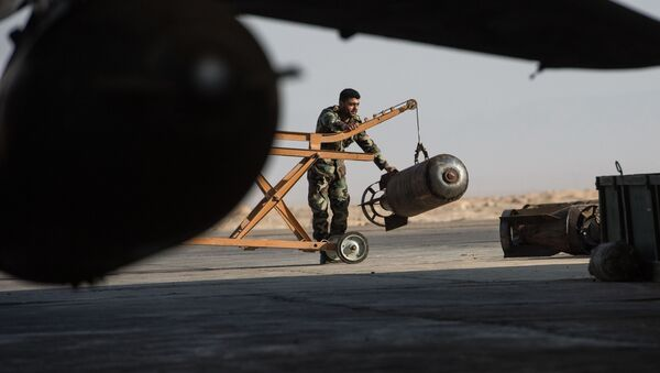 A Syrian army soldier prepares the Su-22 fighter jet for a flight at the Syrian Air Force base in Homs province. File photo - Sputnik International