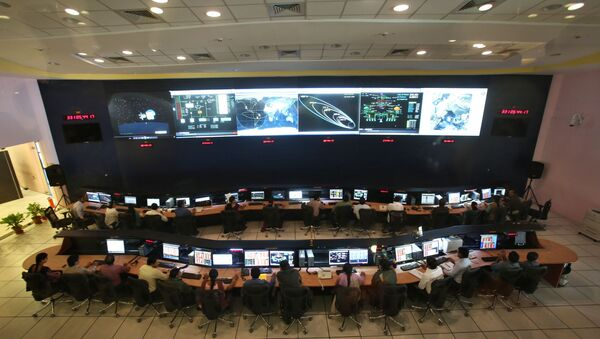 Indian Space Research Organisation (ISRO) scientists and engineers monitor the movements of India's Mars orbiter at their Spacecraft Control Centre in Bangalore, India (File) - Sputnik International
