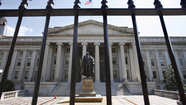 In this Monday, Aug. 8, 2011, file photo, a statue of former Treasury Secretary Albert Gallatin stands guard outside the Treasury Building in Washington - Sputnik International